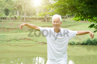 Old man practicing qigong in the park