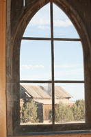 Looking through an old-fashioned Church window with a view of another building