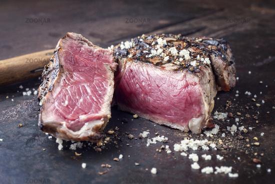 Barbecue Prime Rib Steak on old Metall Sheet