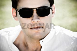 Closeup Of An Attractive Man With Sunglasses