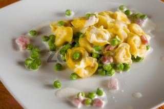 Tortellini with cream ham and peas