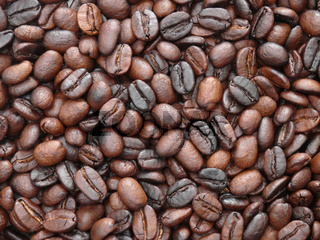Background image of delicious freshly roasted coffee beans
