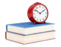 red alarm clock with two books isolated on white background