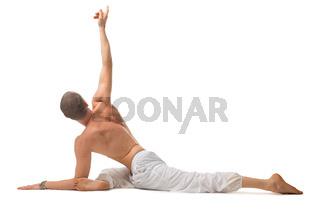 Mature shirtless muscular man doing yoga