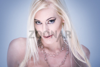 Fashion portrait of a beautiful girl with blonde hair