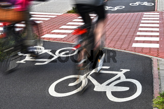 Bicycle road sign and bike riders.