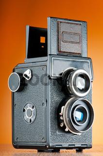 Vintage film camera against gradient background