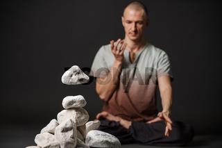 Man in youga pose on the floor studio portrait