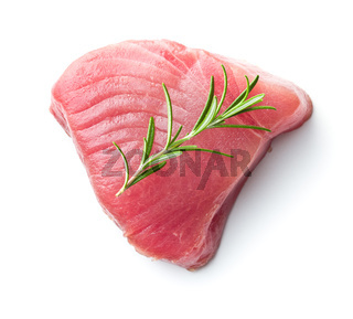 Fresh raw tuna steak and rosemary.