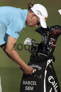 Marcel Siem starts his range practice.