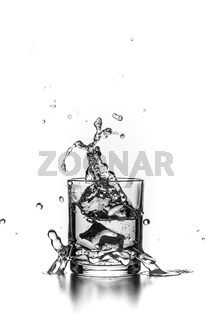 Isolated Water in a glass with splashes