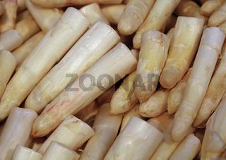 Heap of fresh white asparagus close up