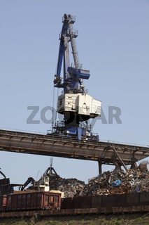 Overhead crane with scrap metal for recycling, DuisPort inland p