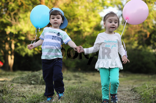 Little children are walking in a park