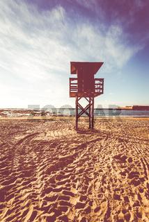 Lifeguard baywatch tower on the sandy beach