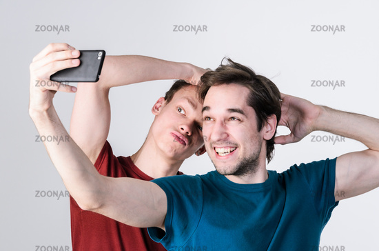 Happy friends are taking selfie