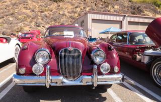 Red 1958 Jaguar XK 150 FHC