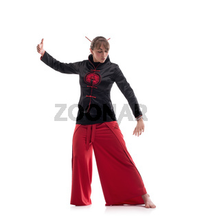 Woman in chinese clothes practicing wushu