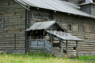Front steps of old wooden country church in north Russia