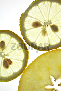 Sliced Lemon and Apple isolated on white