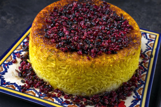 Traditional Iranian Rice pie Tahdig Polo with Berberis on a plate
