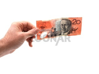 A hand holding cash isolated against a white background