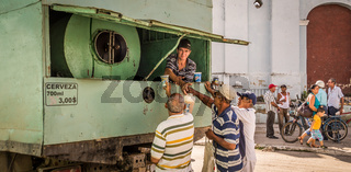 Cuban men buying beer from a truck