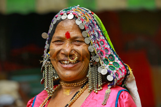 PUNE, MAHARASHTRA, INDIA, June 2017, Traditionally dressed woman smiles at camera
