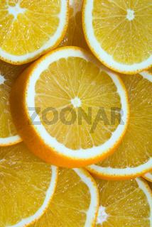 Background the juicy orange cut by round segments