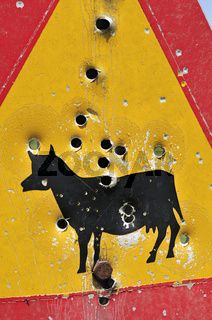 Einschusslöcher in Schild - Bullet holes in sign