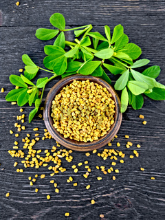 Fenugreek with leaf in bowl on black board top