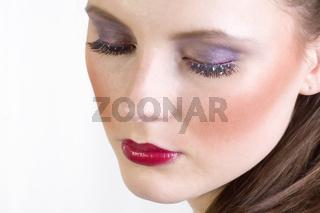 Studioaufnahme einer jungen Frau,  Detailaufnahme vom Gesicht mit Schminke und kuenstlichen Augenlidern, young woman, with artificial eyelid