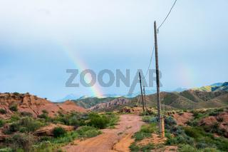 Rainbow over Skazka canyon, kyrgyzstan