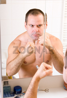 boxer looks in the mirror