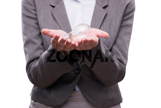 Businesswoman with lightbulb in business concept