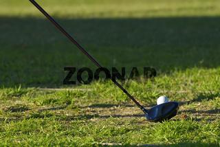 golf iron and ball