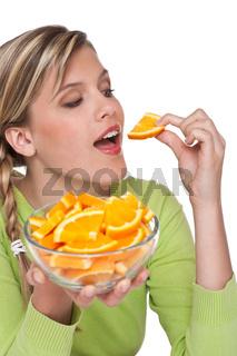 Healthy lifestyle series - Woman eating orange
