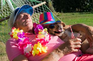 Man with dog in hammock
