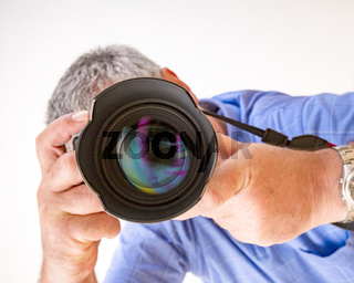 Photographer with a camera when photographing