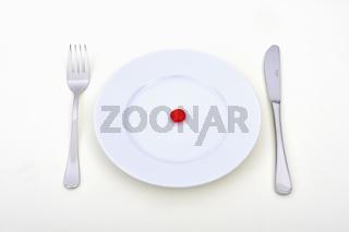 Symbolbild fuer sythetische Lebensmittel. Tablettenkonsum, Tablettenmissbrauch, Diaet