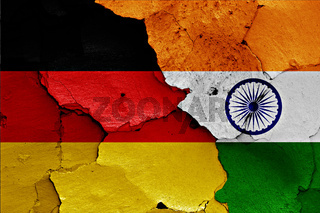 flags of Germany and India painted on cracked wall