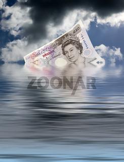 Eine englische 20 Pfundnote versinkt im Wasser