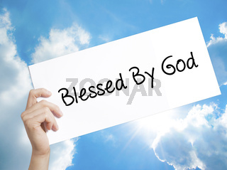 Blessed By God Sign on white paper. Man Hand Holding Paper with text. Isolated on sky background