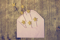 Composition with envelope and golden stars