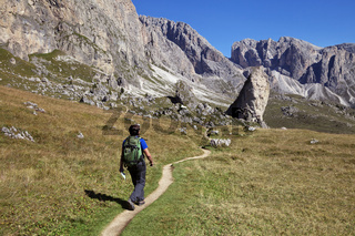 A tourist hiking in Val di Gardena in the Dolomites