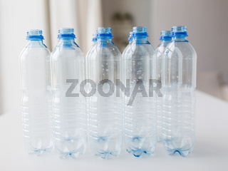 close up of empty used plastic bottles on table