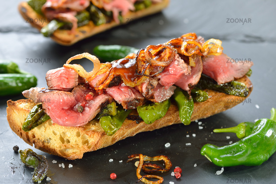 Baguette with pimientos and beef steak