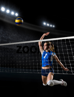 Young girl volleyball player at sports hall