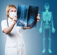 Female doctor looking at an x-ray.
