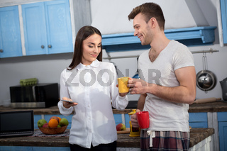 Caring husband giving a cup of coffee to his wife.